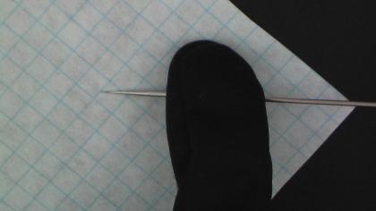 Press Needle onto Sandpaper